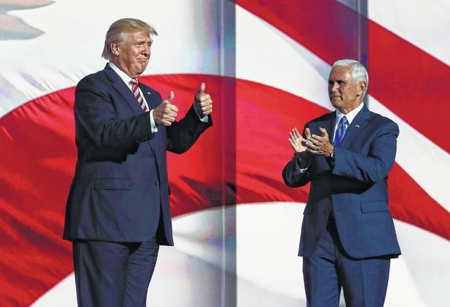 Republican presidential candidate Donald Trump arrives on stage to greet Republican vice presidential nominee Mike Pence, the governor of Indiana, during Wednesday's events at the Republican National Convention in Cleveland. Delegates are optimistic about Trump's intention to fix problems with the U.S. Department of Veterans Affairs.