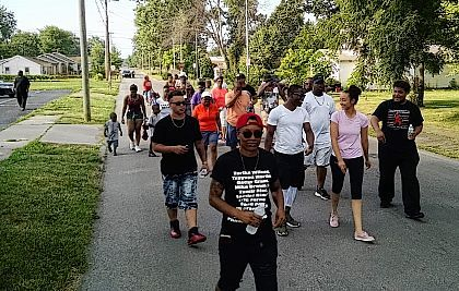 TaLor Jackson (front) leads a group of people Saturday morning holding a Black Lives Matter march through the streets of Lima to raise attention to issues that affect blacks with a focus on local issues.