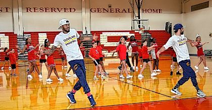 "Members of the Cleveland Cavaliers' ""Scream Team"" perform a dance routine with cheerleaders at Perry schools on Sunday. The visit was made possible by Perry graduate Emily Smith, who works for the Cavaliers organization."