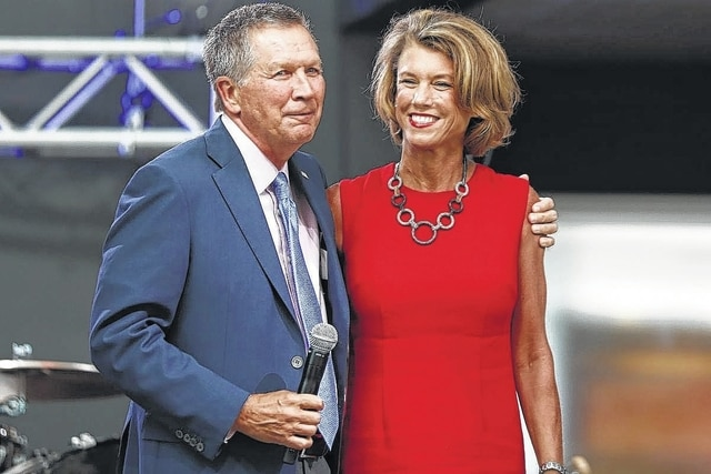 Ohio Gov. John Kasich, left, arrives with his wife Karen at the The Rock and Roll Hall of Fame and Museum on Tuesday, July 19, 2016, in Cleveland, during the second day of the Republican convention.