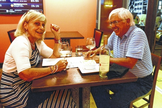Dianne and Mark Bollinger enjoy some wine and appetizers at The Met in downtown Lima.
