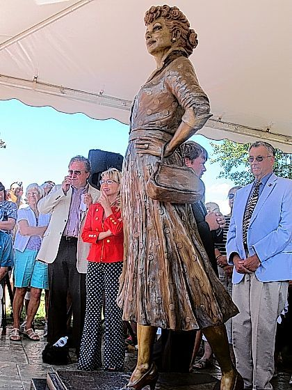 "People gather at the unveiling of the new Lucille Ball statue at Memorial Park in Celoron, N.Y: the late actress's home town, Saturday. The statue, by sculptor Carolyn Palmer, replaces a previous statue of the actress that was referred to as ""Scary Lucy."" The new statue is being shown as part of this year's ""Lucille Ball Comedy Festival."""