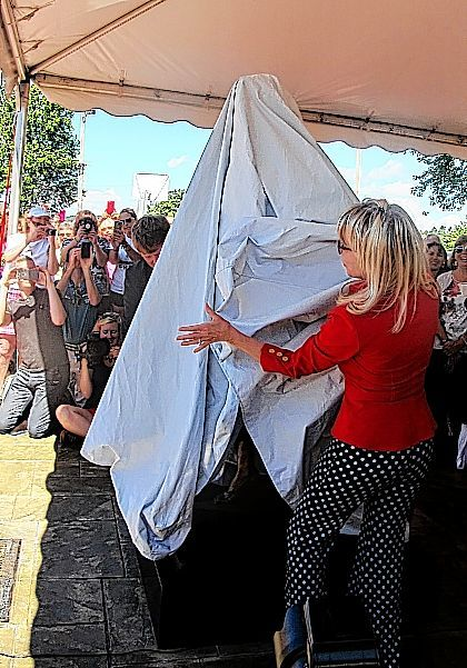 "Sculptor Carolyn D. Palmer prepares to unveil a new statue of Lucille Ball in Celoron, N.Y., on Saturday. Palmer was commissioned to do the statue after the public objected to the previous statue of the late actress on aesthetic reasons, often referring to it as ""Scary Lucy."" Celoron was Ball's hometown and the new statue unveiling became part of the 2016 ""Lucille Ball Comedy Festival."""