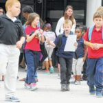 Officials urge extra care as school begins