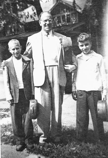 Branson Harley Holmes with two students in an unknown year.