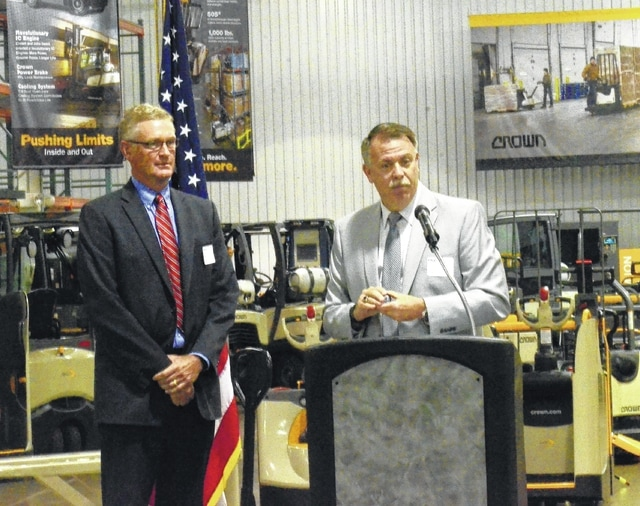 Ohio Department of Veterans Services Director Chip Tansill, right, stands with Randy Niekamp, vice president of human resources at Crown Equipment, during a ceremony Wednesday. Tansill visited Crown to show appreciation for the company's dedication to hiring military veterans.