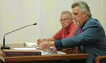 Lima business owner Tim DeHaven, left, sits with his attorney, Robert Grzybowski, during a diversion hearing Tuesday at Allen County Common Pleas Court.