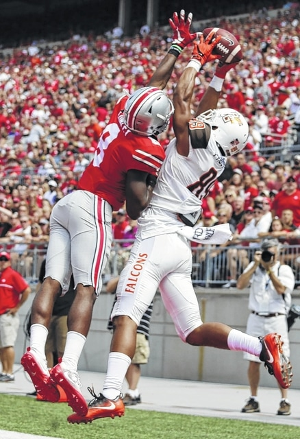 Ohio State cornerback Gareon Conley (8) knocks the ball away from Bowling Green wide receiver Deric Phouthavong during Ohio State's 77-10 win over the Falcons last Saturday.