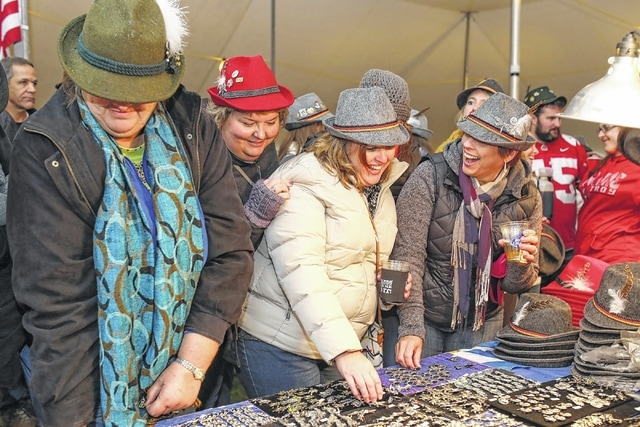 Friends and family choose the perfect pin for their hats during a past Oktoberfest in Minster.