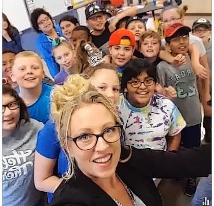 Local author, CEO/publisher Elena Rahrig helps fifth-grade class in Illinois.