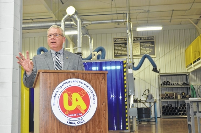 Mike Knisley, business manager of the United Association of Plumbers, Pipefitters and Service Technicians Local 776, discusses the expansion of the organization's training facility during a ribbon-cutting ceremony Thursday.