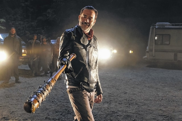 """In this image released by AMC, Jeffrey Dean Morgan portrays Negan in a scene from the Season 7 premiere of """"The Walking Dead."""" The gory episode of the popular AMC drama was seen by just over 17 million viewers on Sunday night, the Nielsen company said."""