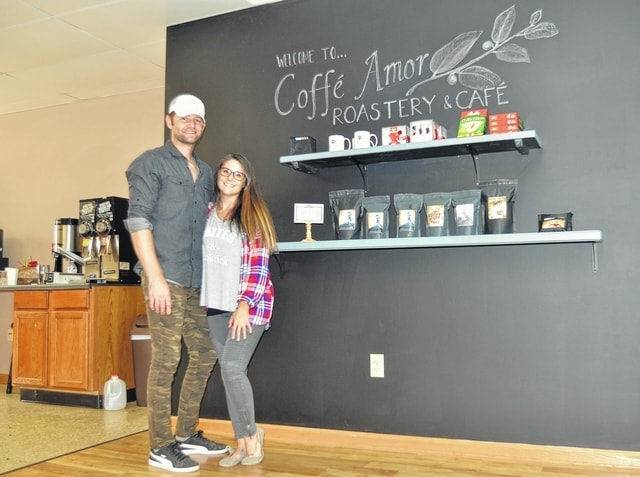 Coffe Amor owners David Tilton and Gabrielle Cziraky stand together in their cafe in Wapakoneta. The couple donates 10 percent of their profits to missionary projects at home and abroad.