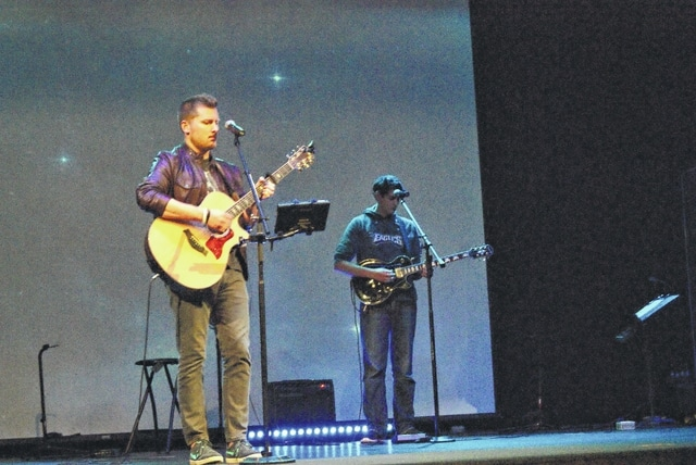 Shawnee Alliance Church uses a modern praise band with a service that was described as a weekly celebration of what Jesus has done.