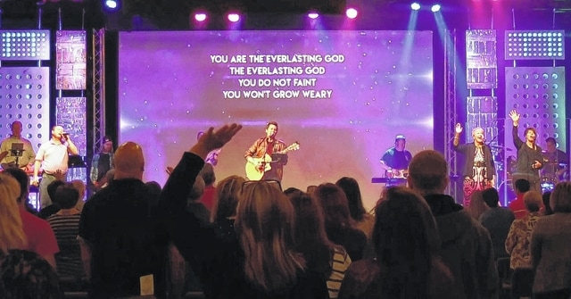 Daniel Stephens plays acoustic guitar and leads the praise band at Shawnee Alliance Church.