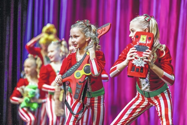 """The elves sing and dance to the song """"Cool Yule"""" during a past Holiday Spectacular."""