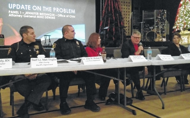 Allen County Coroner Dr. Gary Beasley, second from right, speaks at a faith-based heroin addiction forum Friday at Shawnee Alliance Church.