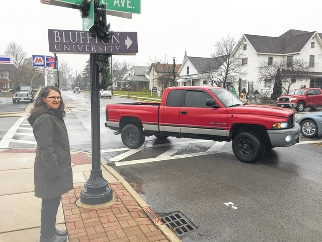 Paula Pyzick Scott, of Bluffton, stands at the northeast corner of Main Street and College Avenue. She says the intersection is dangerous for pedestrians. She's seeking improvements, such as a flashing pedestrian-activated beacon, to make the crosswalk safer.