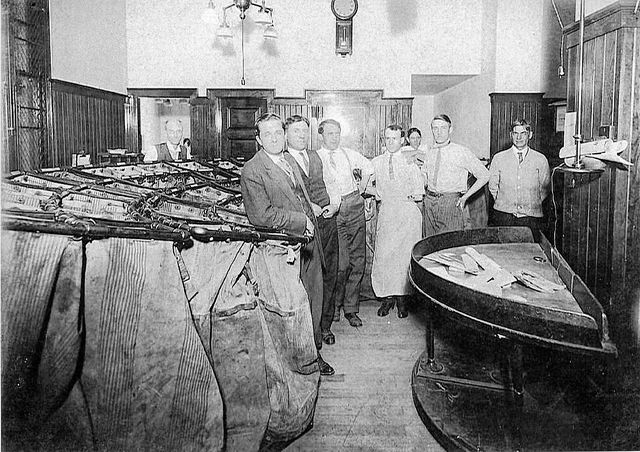 An interior view of the old post office and some of its workers.