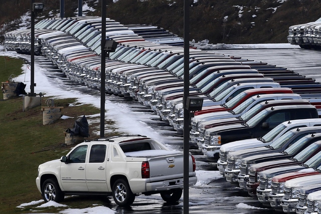 In this Jan. 9, 2013, file photo, Chevy trucks line the lot of a dealer in Murrysville, Pa. Demand may be slowing, but U.S. consumers still bought a whole lot of cars and trucks in 2016.