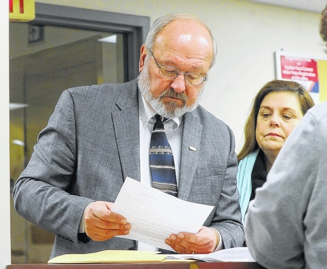 Mayor David J. Berger hands in his nominating petitions seeking re-election to the position of Mayor for the City of Lima at the Allen County Board of Elections. Standing next to Berger is his wife, Linda.