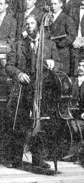 This photo of Charles Henry Crockett from 1908 shows him as part of the Lima Choral Society. He played bass in the Faurot Opera House orchestra for 28 years and cello, flute and piccolo for weddings, dances and concerts. He was a member of the city band from 1873 to 1919, playing tuba, alto or saxophone. In his spare time he lent his bass voice to church choirs and public events.