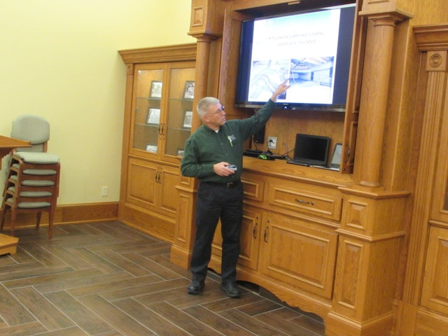 Dan Klear discusses energy saving practices at a meeting in Bluffton on Tuesday.