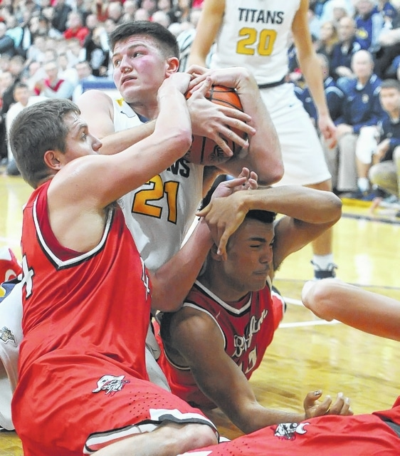 Ottawa-Glandorf's Jake Dible, center, goes to the floor with Bluffton's Gabe Denecker, left, and Kaleb Jefferson during Saturday night's game at Ottawa-Glandorf High School.