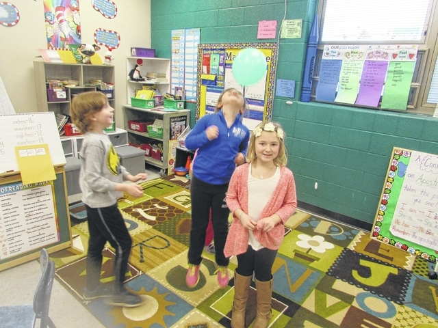 From left, Christopher Keysor, Lilian Prine and Lauren Counts play a game Friday in Tami Klum's class at Allen East. The game is part of the Pax Good Behavior Game.