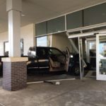 Driver runs truck through entryway of Lima Memorial Professional Office Building