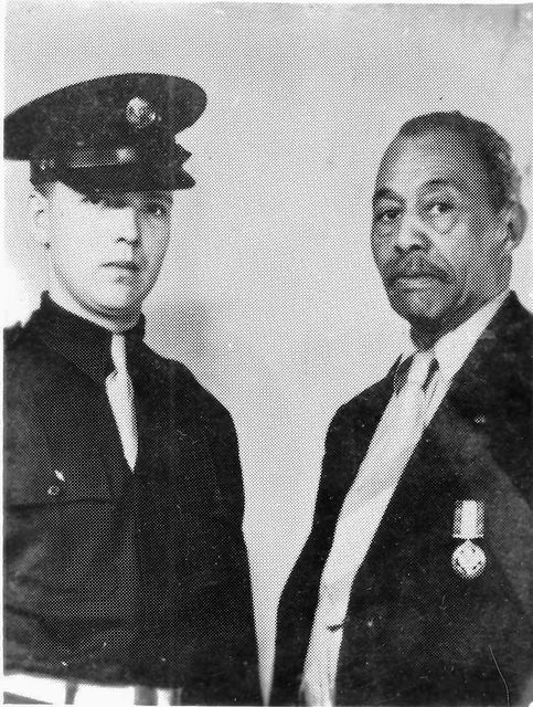 "Second Lt. Peter McCown, wearing the Distinguished Service Medal which he is sending to Washington in exchange for a Distinguished Service Cross. He was awarded the the medal in 1931 for ""conspicuous gallantry"" in the Spanish-American War at Cuba. He is shown with Sgt. Joseph Price, local Army recruiting agent, who assisted in his correspondence with Washington."