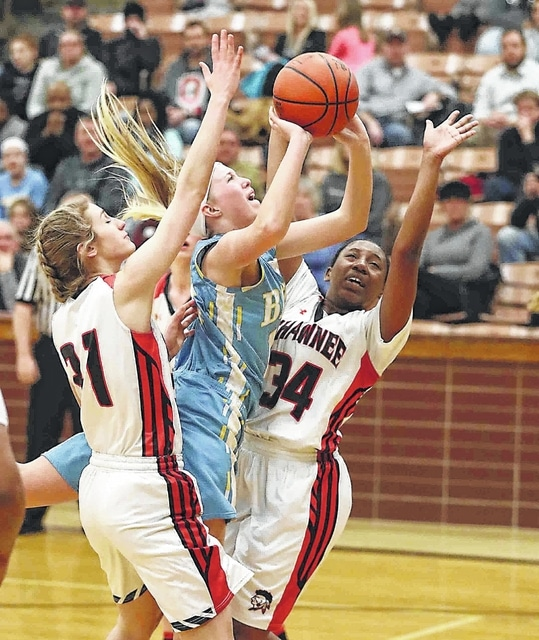 Bath's Lindsey Singhaus drives to the basket against Shawnee's Norah Painter, left, and Ijah Austin during Thursday night's game at Shawnee High School.