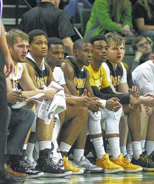 Dantez Walton (second from the left) and Tre Cobbs (third from the left) watch from the Northern Kentucky bench in a game against Wright State in Dayton.