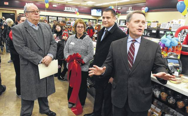 Terry Handley, right, CEO of Casey's General Store, addresses the grand opening of the new Cridersville store on Friday.