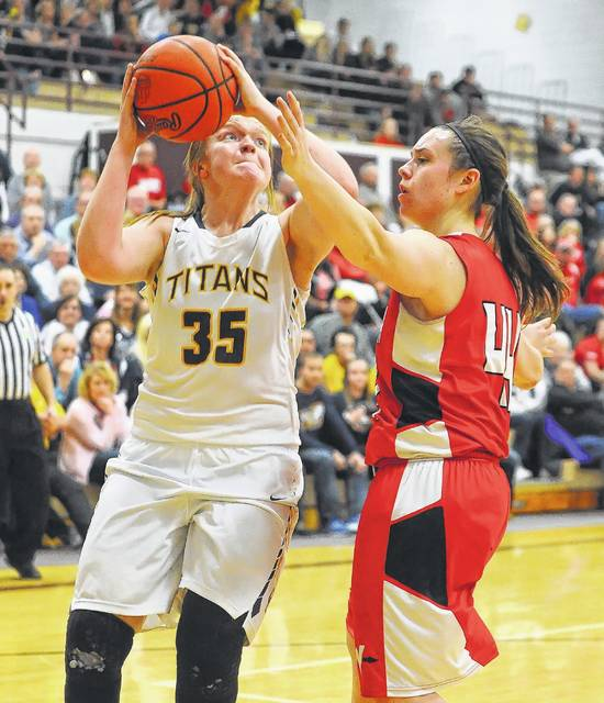 Ottawa-Glandorf's Kadie Hempfling puts up a shot against Wapakoneta's Blasia Moyler during Saturday's Division II district final at Paulding High School.