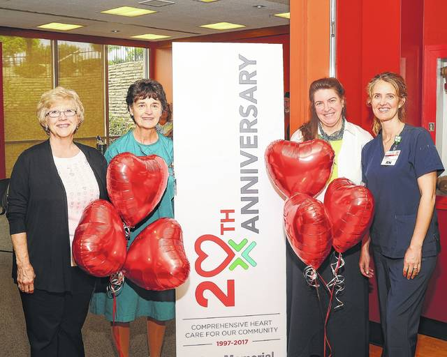 Lima Memorial Health System original cardiac staff consists of (from left) Donna Stroh with 26 years, Connie Callahan with 50 years, Wendy Rayl with 25 years and Hope Bish with 23 years experience. They helped celebrate the 20th Anniversary of Heart Care at Lima Memorial Health System on Friday.