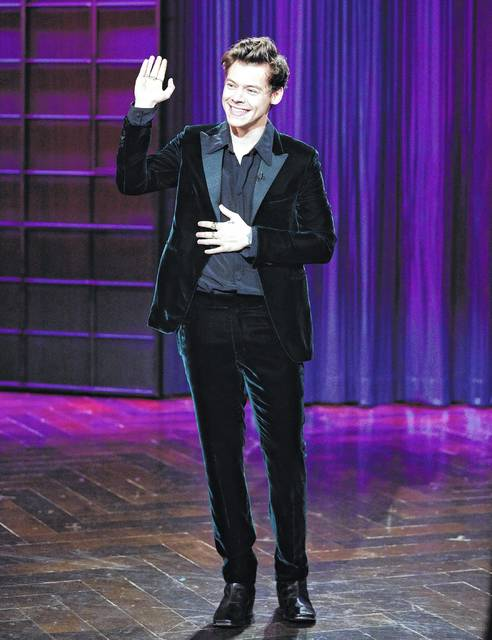"""Harry Styles appears on """"The Late Late Show with James Corden"""" on Tuesday. Styles took over Corden's show for a night by telling a few jokes and poking fun at President Donald Trump and Hillary Clinton. Corden appeared as Styles during a skit and later resumed hosting duties."""