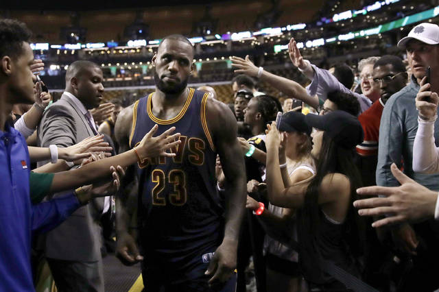 Cleveland Cavaliers forward LeBron James leaves the court after Game 1 of the team's NBA basketball Eastern Conference finals against the Boston Celtics, Wednesday in Boston. The Cavaliers won 117-104.
