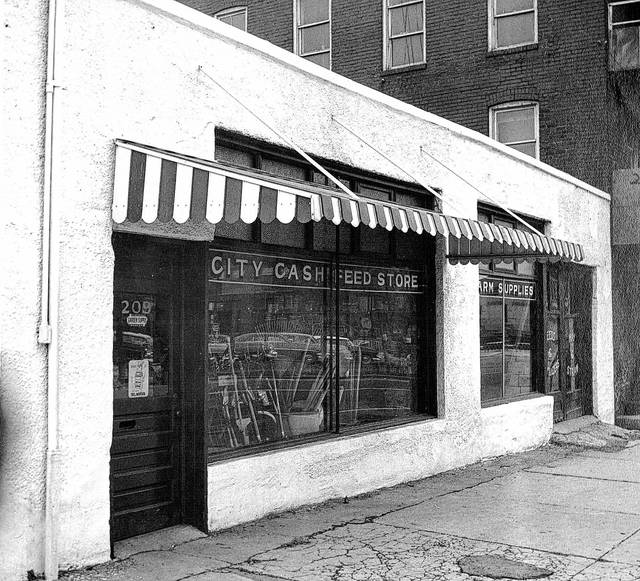 The City Cash Feed Store, pictured here in 1958, dates back to the 1920s in Lima. The business would change names a few times, reflecting changes in ownership.