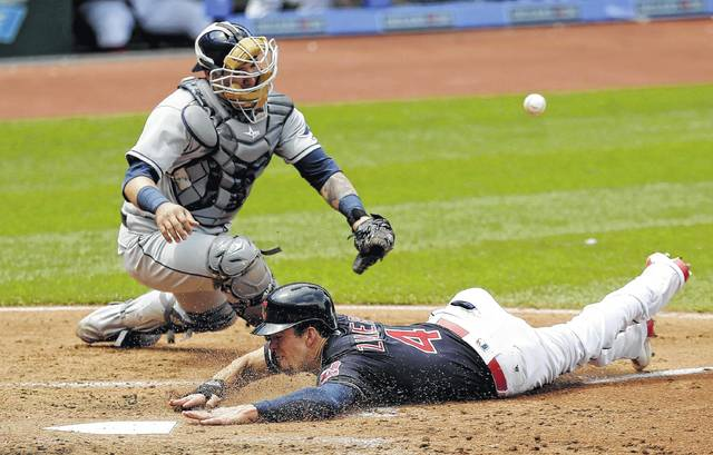 Cleveland Indians' Bradley Zimmer slides safely into home plate as Tampa Bay Rays catcher Jesus Sucre can't hold onto the ball in the third inning of a baseball game, Wednesday, May 17, 2017, in Cleveland. Zimmer scored on Jason Kipnis's single. (AP Photo/Tony Dejak)