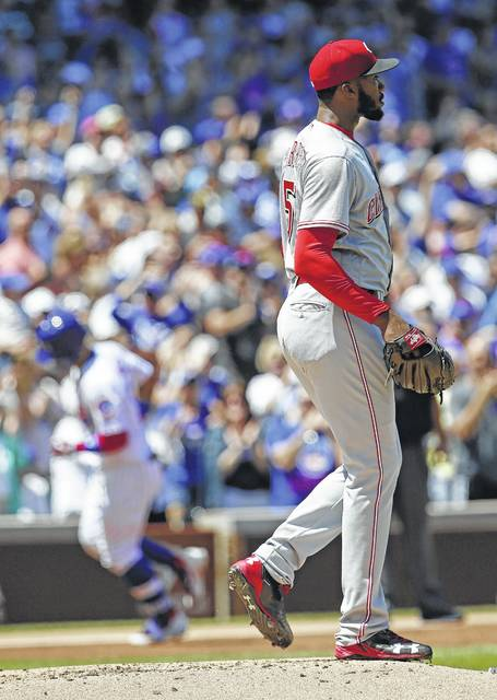 Cincinnati Reds starting pitcher Amir Garrett reacts after Chicago Cubs' Javier Baez hit a grand slam during the first inning of a baseball game in Chicago, Thursday, May 18, 2017. (AP Photo/Nam Y. Huh)