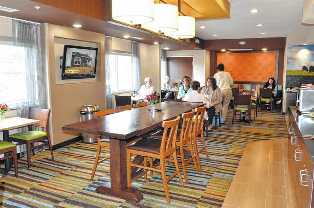 Guests enjoy a meal at Fairfield Inn & Suites' new dining area near the main lobby of the hotel.
