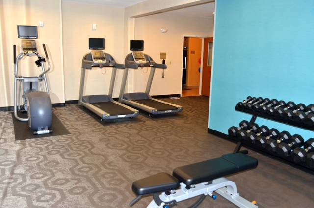 John Bush | The Lima News A fitness center is one of the new amenities that were added during the renovation at Fairfield Inn & Suites. The workout area includes free weights for strength training, as well as stationary bikes and treadmills for cardio work.