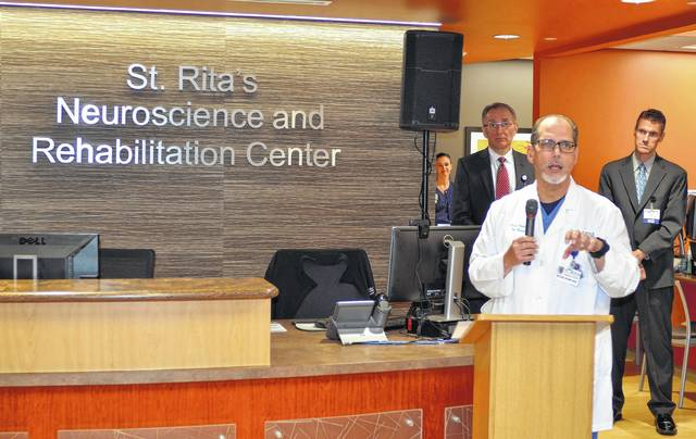 Dr. Michael Rivera, a pain management specialist at St. Rita's Medical Center, speaks at a ribbon-cutting ceremony Tuesday for the hospital's Neuroscience and Rehabilitation Center.