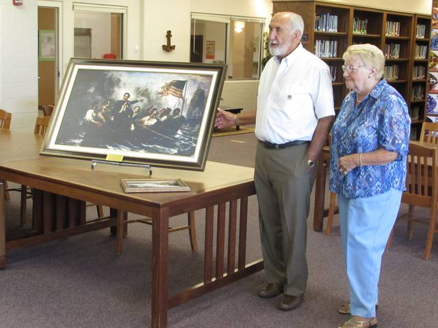 Larry and Beverly Spees talk about the painting they donated to Perry schools. The painting is a reprint of the original that hangs in the Ohio Statehouse rotunda.