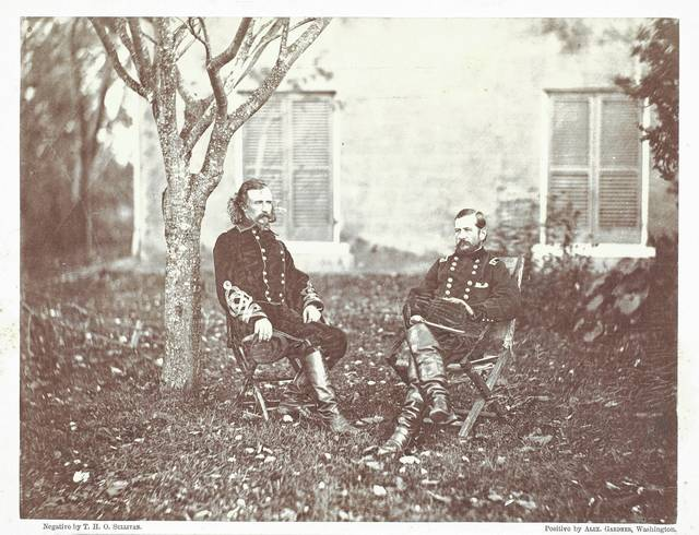 This photograph of General Custer (left) and Major General Pleasanton was made in 1863 by Timothy H. O'Sullivan.