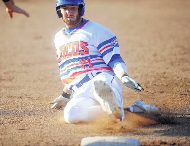 The Lima Locos' Josh DeBacker slides into third after hitting a triple during Tuesday night's game against Lorain County at Simmons Field.