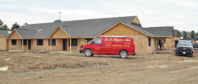 "John Bush | The Lima News A work van sits in front of the first of several apartment buildings that are being constructed on Allentown Road in Lima. Developers described them as ""luxury"" apartments that feature a long list of amenities."
