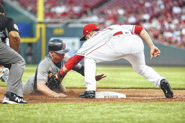 Arizona's Brandon Drury is caught stealing by Reds third baseman Eugenio Suarez during Tuesday night's game in Cincinnati.