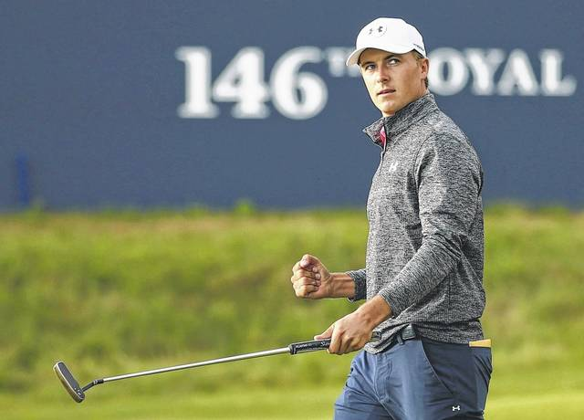 Jordan Spieth does a fist pump after recording a birdie on the 18th hole during Saturday's third round of the British Open Championship, at Royal Birkdale in Southport, England.